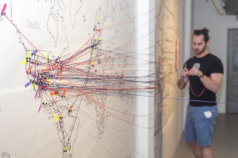 Christine Wong Yap, untitled installation view (participatory mapping exercise: detail of world map for migration stories), 2017, participation, paper, markers, pins, yarn, dimensions variable (Photo: Michael Apolo Gomez)